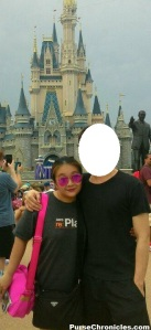 My husband and I in Disney World Orlando last July. My dear hubby is quite shy and didn't want his picture posted so I blocked his face out :P  I'm carrying my black Prada vela nylon shoulder bag (used as cross-body here), which is my go-to amusement park bag. The hot pink bag is our daughter's :)